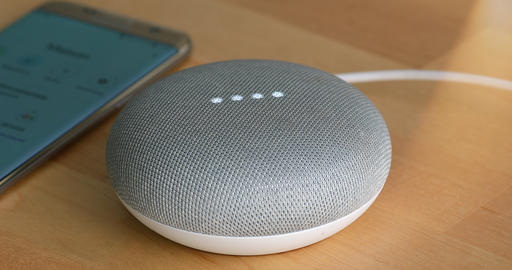 Google Home Mini With Smartphone On The Wooden Table Footage