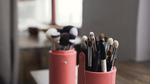 Brush set for make-up on table in studio. Professional make-up tools. A set of Live Action