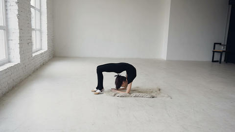 Yoga - gymnastic girl make exercise training in sport school. Flexibility Live Action