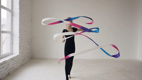 Flexible gymnast with colored tape creates beautiful and graceful movement in Live Action
