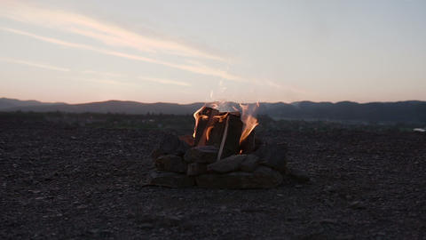 Picnic on the nature. Red ember glowing in ash fireplace wood burning fire with Footage