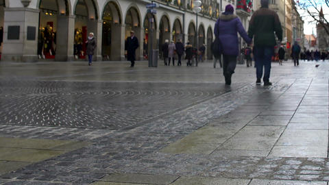 MUNICH, GERMANY - CIRCA JANUARY 2016: People in the city. People walking Munich Live Action