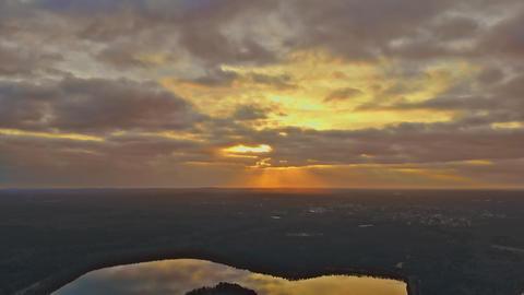 Early morning sunrise at lake, golden light of sunrise illuminating Live Action