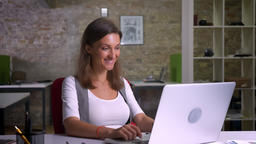 Attractive female office worker typing and messaging on... Stock Video Footage