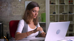 Attractive office worker typing on the laptop caughing feeling ill on the Footage