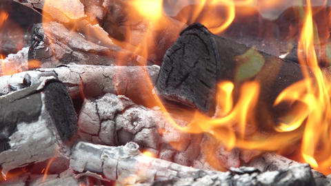 Decaying coals for cooking and a background Live Action