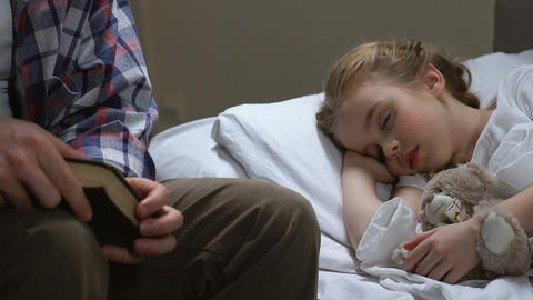 Dad stroking sleeping daughter head with love, family connection, love to child Live Action
