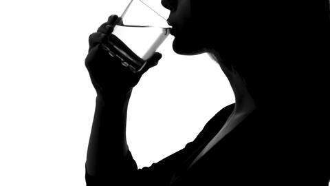 Woman shadow drinking water from glass, aqua balance, body hydrating, health Footage