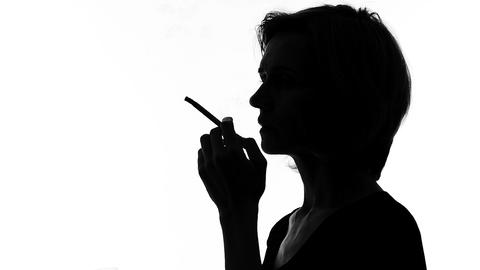 Sad woman drinking wine and smoking, dangerous habit addiction, loneliness Footage