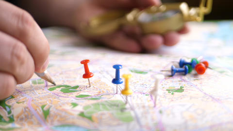 Travel destination points and compass on a map Live Action