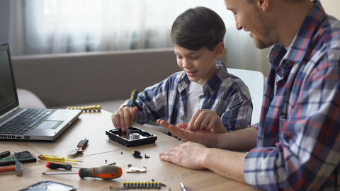 Father and son repairing small household appliances, support and reliance Footage