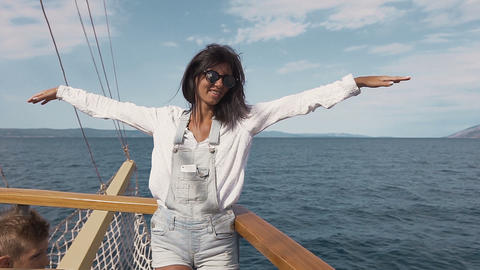 Beautiful young woman on a ship. The ship is approaching the coast of Split on a Live Action