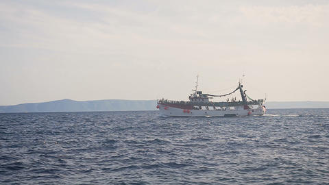 A cruise ship sails on the high seas. People on the ship. Dalmatia. Croatia Live Action