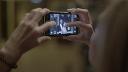 Girl is photographed on the mobile phone of the actor and actress Footage