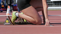 Girl runner starts with a low start 400 meters Footage