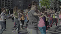 People dance a merry dance on the street. Aerobics. Fitness Footage