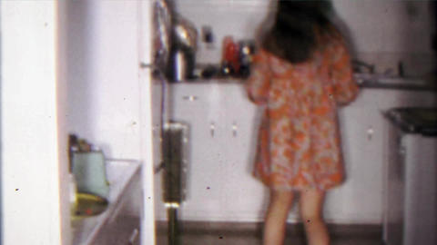 1968: College student hippy girl gets creamed corn from refrigerator Footage