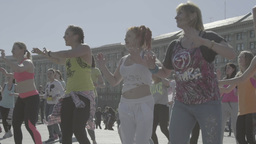 People dance a merry dance on the street. Slow motion Footage