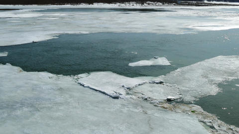 cracked ice floating on the river in spring time Footage