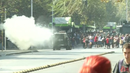 POLICE TRUCK THROWING OFF GASES TO DISPERSE THE PROTESTERS Footage