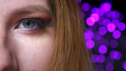 Closeup of gorgeous blue eye makeup with pink shades and long eyelashes Footage
