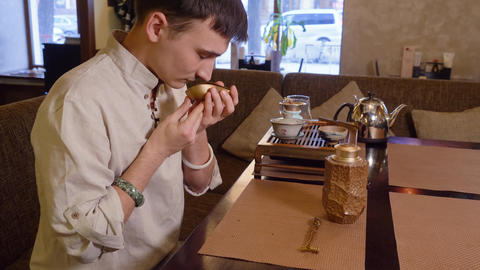 Master sniffing tea leaves in chahai while ceremony. Traditional tea ceremony Live Action