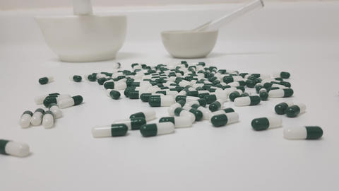 White green capsules in pharmacy laboratory traveling Footage