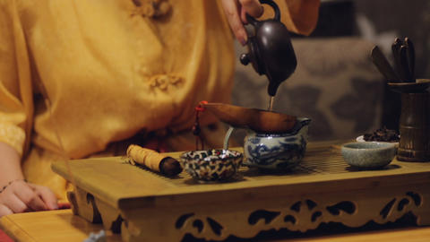 Oriental female making herbal tea European tourists, Chinese cultural activity Footage