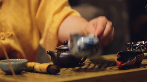 Exhibition of tea ceremony in asian restaurant, Chinese culture, set of rituals Live Action