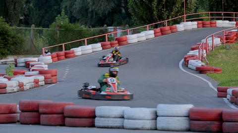 Entertainment complex customers operating go-carts, speed challenge, leisure Live Action