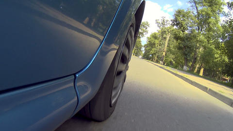 Car moving on green trees city road, active lifestyle, road journey, tourism Footage
