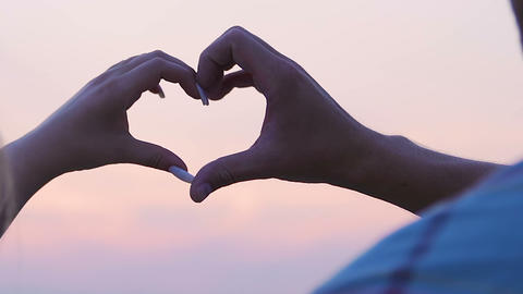 Couple hands making heart sign sky background, love symbol, romantic relations Live Action