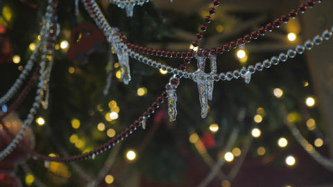 Christmas garland on which hang icicles. Close-up Live Action