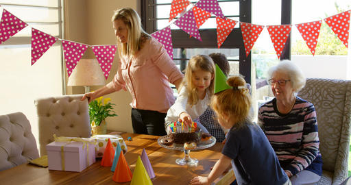 Multi-generation family celebrating birthday in living room at home 4k Live Action