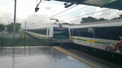 Medellin Metro, Colombia. Two trains at the station platform. Mass transport Live Action