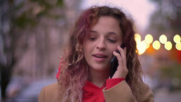 Close-up portrait of young blonde caucasian girl smilingly talking on cellphone Footage