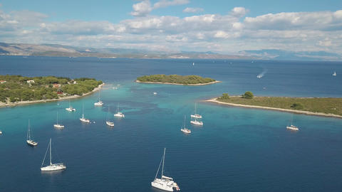 Aerial view of cozy mediterranean island. Blue lagoon, island paradise. Adriatic Footage