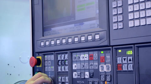 Man working on the control panel works with an industrial machine close-up Footage