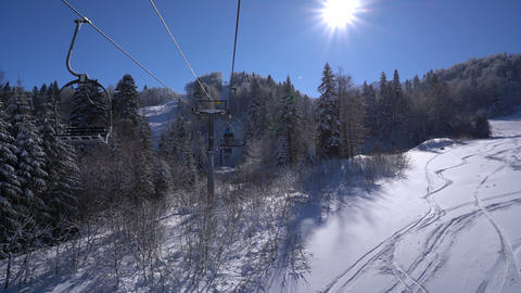 Snow forest and skiers on a ski lift pov 영상물