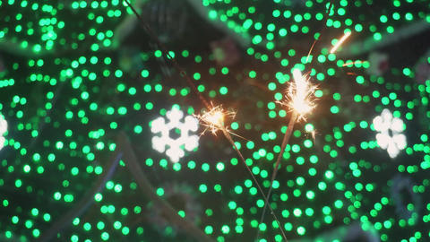 Bengal fires, sparklers and colorful bokeh christmas, new year background Footage
