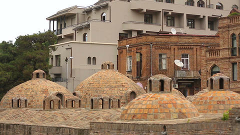 Abanotubani sulfuric baths in ancient district of Tbilisi, famous tourist place Live Action
