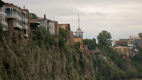 Houses built on edge of cliff in Tbilisi, Georgia, natural disaster hazard, risk Live Action