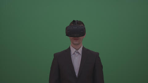 Young Black Haired Male Wearing Brown Jacket And White Shirt Using VR Surprised Live Action