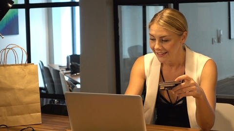 Business Blonde Girl shops online via laptop, online... Stock Video Footage