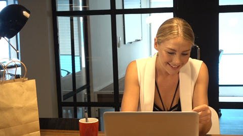 Business Blonde Girl shops online via laptop, online shopping concept Footage