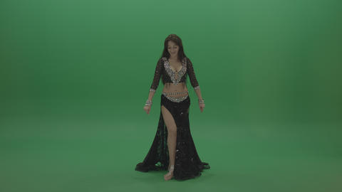 Beautiful belly dancer in black wear display exceptional dance moves over Live Action
