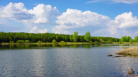 Clouds in smooth water of lake, panorama timelapse Footage