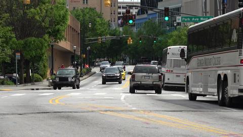 Street view Atlanta with Georgia Military College Buses - ATLANTA, GEORGIA - APR Live Action
