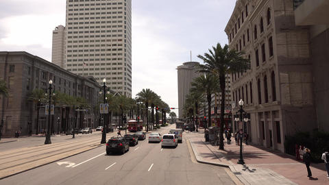 Street view and traffic on Canal street New Orleans - NEW ORLEANS, LOUISIANA - A Live Action