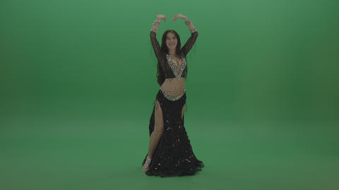 Beautiful belly dancer in black wear display amazing dance moves over chromakey Live Action